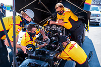 Aug 8, 2020; Clermont, Indiana, USA; Crew members replace the blower pully on the engine for NHRA funny car driver J.R. Todd during qualifying for the Indy Nationals at Lucas Oil Raceway. Mandatory Credit: Mark J. Rebilas-USA TODAY Sports