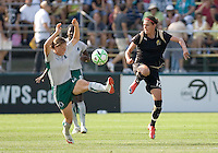 Kendall Fletcher (left) and Christine Sinclair (12) leap for control of the ball. FC Gold Pride tied the St. Louis Athletica 1-1 at Buck Shaw Stadium in Santa Clara, California on August 9, 2009.