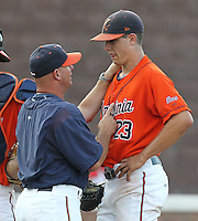 Virginia pitching coach Karl Kuhn talks with pitcher Danny Hultzen during game four of the 2011 NCAA regionals last weekend. Photo/Andrew Shurtleff