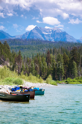 Canoes on the shore of the North Fork of the Flathead River in northwest Montana with the MacDonald Mountain Range in Glacier National Park