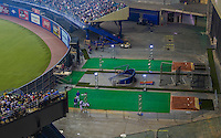 28 March 2014: New bullpens built behind the outfield fences are lit with extra lighting, as a crowd of 46,121 enjoy a pre-season exhibition game between the Toronto Blue Jays and the New York Mets at Olympic Stadium, in Montreal, Quebec. The Blue Jays then broke a 4-4 deadlock in the bottom of the 9th to edge out the Mets 5-4 in the first MLB game in Montreal since September 29, 2004. Mandatory Credit: Ed Wolfstein Photo *** RAW (NEF) Image File Available ***
