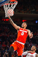 NEW YORK, NY - Sunday December 13, 2015: Michael Gbinije (#0) of Syracuse  goes up for a lay-up.  St. John's defeats Syracuse 84-72 during the NCAA men's basketball regular season at Madison Square Garden in New York City.