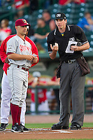 Home plate umpire Nate Tomlinson goes over the ground rules with Wisconsin Timber Rattlers manager Matt Erickson (8) prior to the game against the Great Lakes Loons at the Dow Diamond on May 4, 2013 in Midland, Michigan.  The Timber Rattlers defeated the Loons 6-4.  (Brian Westerholt/Four Seam Images)