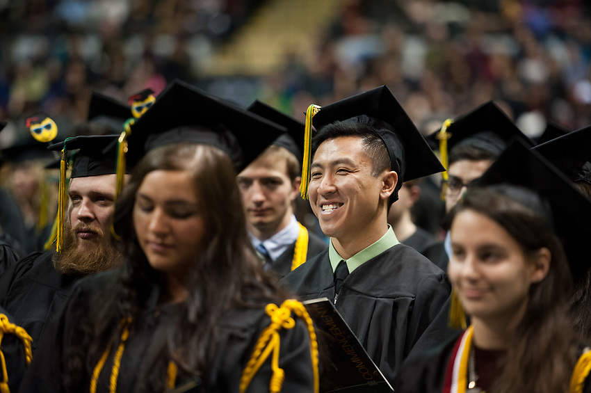 Sikharin B. Kitchpanich, BS Engineering, is all smiles after receiving his degree during UAA's Fall 2017 Commencement.