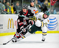 26 November 2010: Northeastern University Huskies' forward Mike McLaughlin, a Junior from Seaforth, Ontario, in action against University of Vermont Catamount forward Josh Burrows, a Senior from Prairie Grove, IL, at Gutterson Fieldhouse in Burlington, Vermont. The Huskies came back from a 2-0 deficit to earn a 2-2 tie against the Catamounts. Mandatory Credit: Ed Wolfstein Photo