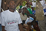 A group of men at Kilometre 36, 36 kilometers from Conakry, Guinea, listen to an HIV/AIDS educational session conducted by peer educators trained by PSI-Guinea.  Kilometre 36 is the intersection of several major routes to neighboring countries.    Transport workers are a high-risk group for HIV/AIDS due to the amount of time they spend away from home.