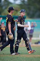 Pitcher Kyle Percival (22) and catcher Ryan McCrystal (9) during the WWBA World Championship at Terry Park on October 11, 2020 in Fort Myers, Florida.  Ryan McCrystal, a resident of Fuquay Varina, North Carolina who attends Fuquay-Varina High School, is committed to East Carolina.  (Mike Janes/Four Seam Images)