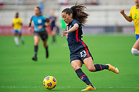 ORLANDO CITY, FL - FEBRUARY 21: Christen Press #23 of the USWNT dribbles the ball during a game between Brazil and USWNT at Exploria Stadium on February 21, 2021 in Orlando City, Florida.