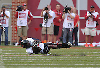 NWA Democrat-Gazette/MICHAEL WOODS • @NWAMICHAELW<br /> Texas Tech defender Tevin Madison makes an interception in the 1st quarter of Saturday nights game at Razorback Stadium in Fayetteville.