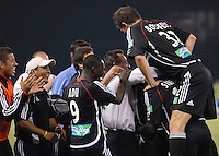 DC United midfielder Ben Olsen (14) celebrates with teammates and head coach Peter Nowak after scoring his goal. DC United defeated the Columbus Crew 3-2, Saturday, July 15, 2006.