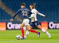 LE HAVRE, FRANCE - APRIL 13: Elisa De Almeida #22 of France is defended by Alex Morgan #13 of the USWNT during a game between France and USWNT at Stade Oceane on April 13, 2021 in Le Havre, France.
