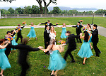 Wedding Party Dances Around Bride and Groom