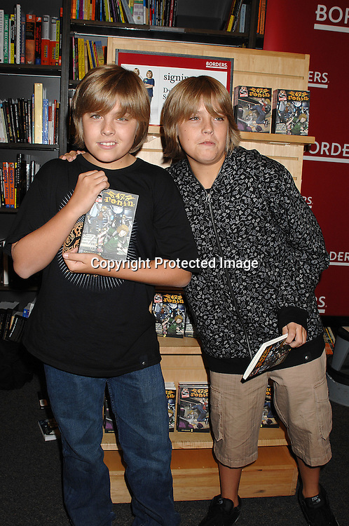 """Dylan Sprouse and Cole Sprouse ..posing for photos at a signing for their new book..""""Sprouse Bros 47 R.O.N.I.N on September 19, 2007 at ..Borders Books in Time Warner Center. ..Photo by Robin Platzer, Twin Images......212-935-0770"""