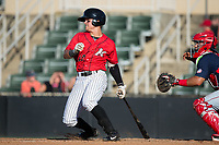 Mitch Roman (10) of the Kannapolis Intimidators follows through on his swing against the Hagerstown Suns at Kannapolis Intimidators Stadium on June 14, 2017 in Kannapolis, North Carolina.  The Intimidators defeated the Suns 4-1 in game one of a double-header.  (Brian Westerholt/Four Seam Images)