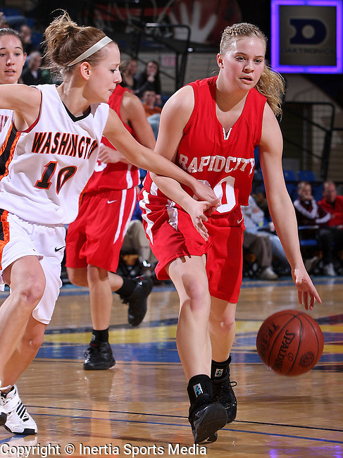 BROOKINGS, SD - March 13, 2009 : Rapid City Central's Betsy Moler #30 attempts to drive the lane while being pressured by Sioux Falls Washington's Amanda Farritor #10 during their State Girls AA Basketball Tournament in Brookings at Frost Arena on Friday. (Photo by Stephen Brua/Inertia)