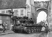 BNPS.co.uk (01202) 558833<br /> Pic: TankMuseum/BNPS<br /> <br /> A Cromwell tank in Europe after D-Day - it was on one of these that Little Audrey sat and worked as a mascot for the crew.<br /> <br /> <br /> A delicate china doll that served as the lucky mascot for a British tank crew and miraculously survived the war in one piece has been unearthed by a museum. <br /> <br /> The small doll, called Little Audrey, had been given to Lionel 'Bill' Bellamy by his then girlfriend Audrey before he set out for Normandy in 1944. with the Royal Armoured Corps.<br /> <br /> She was adopted by the troop and was attached to Bellamy's Cromwell tank's searchlight to the right of the turret and she became a good luck charm – and they needed her.<br /> <br /> Little Audrey remained with the men as they fought through France, Belgium, Holland and Germany. She is now going on display at the Tank Museum at Bovington, Dorset.