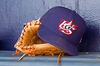 A Team USA cap sits on top of a glove in the dugout at Durham Bulls Athletic Park July 18, 2010, in Durham, North Carolina.  Photo by Brian Westerholt / Four Seam Images
