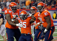 ATLANTA, GA - DECEMBER 31: Kevin Parks #25 of the Virginia Cavaliers reacts with teammayes after scoring a touchdown during the 2011 Chick Fil-A Bowl against the Auburn Tigers at the Georgia Dome on December 31, 2011 in Atlanta, Georgia. Auburn defeated Virginia 43-24. (Photo by Andrew Shurtleff/Getty Images) *** Local Caption *** Kevin Parks