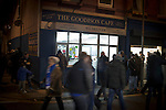Everton 0 West Bromwich Albion 0, 19/01/2015. Goodison Park, Premier League. Spectators walking past a cafe outside Goodison Park, Liverpool before the Premier League match between Everton and West Bromwich Albion. The match ended in a 0-0 draw, despite the home team missing a first-half penalty by Kevin Mirallas. The game was watched by 34,739 spectators and left both teams languishing near the relegation zone. Photo by Colin McPherson.