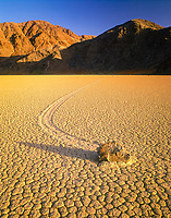 Incredible windblown boulders at the 'Racetrack' at sunset, Death Valley National Park, California, USA