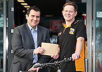 11/01/12  Stephen Roche, Store Manager at Halfords Carrickmines, Dublin is congratulated by Area Manager, Phil Barr for being the top selling Halfords Store in the week before Christmas throughout the whole of Ireland and the UK. .They sold one bike every eight minutes  during store hours. The staff and manager were congratulated by Phil Barr, and were rewarded with a team evening out paid for by Halfords....Picture Colin Keegan, Collins, Dublin.