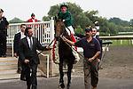 Gio Ponti enters the winners circle for the Arlington Million
