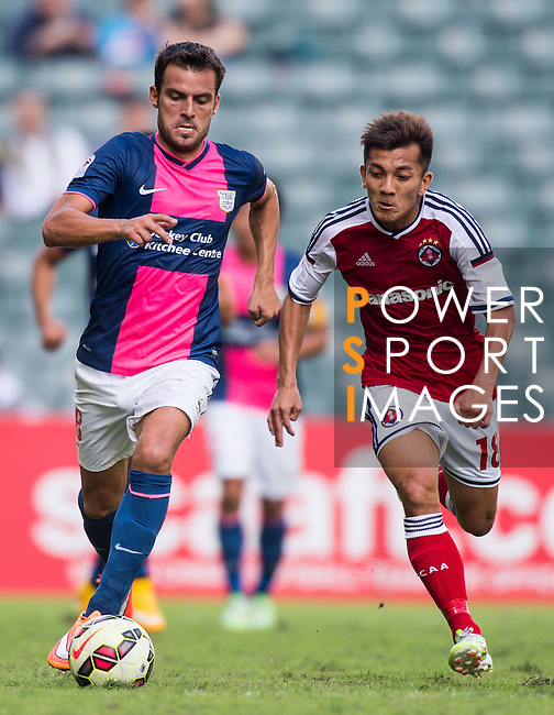 Jorge Tarres of Kitchee (L) being followed by Kin Pong Kwok of SCAA (R) during the HKFA Premier League between South China Athletic Association vs Kitchee at the Hong Kong Stadium on 23 November 2014 in Hong Kong, China. Photo by Aitor Alcalde / Power Sport Images