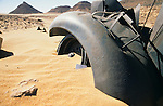Africa, Libya, Fezzan. A son's business card - in memory of a his father who served with the Long Range Desert Group - left at the .remains of one LRDG Chevrolet truck in a valley of the Gebel Sherif mountains southwest of Kufra. During Second World War on January 31 1941 the Long Range Desert Group was attacked by the Italian Compagnie Sahariane. Libyen 1999/2000.<br /> <br />  --- No releases available. Automotive trademarks are the property of the trademark holder, authorization may be needed for some uses.<br /> <br />  --- INFO: The Long Range Desert Group (LRDG) was a reconnaissance and raiding unit of the British Army during the Second World War. Originally called the Long Range Patrol Unit (LRP), the unit was founded in Egypt in June 1940 by Major Ralph A. Bagnold. Bagnold was assisted by Captain Patrick Clayton and Captain William Shaw. At first the majority of the men were from New Zealand, but they were soon joined by Rhodesian and British volunteers, and the name was changed to the better-known Long Range Desert Group (LRDG).<br /> <br /> The LRDG vehicles were mainly two wheel drive, chosen because they were lighter and used less fuel than four wheel drive. They were stripped of all non-essentials, including doors, windscreens and roofs. They were fitted with a bigger radiator, a condenser system, built up leaf springs for the harsh terrain, wide, low pressure desert tyres, sand channels etc. Initially the LRDG patrols were equipped with one CMP Ford 15 cwt F15 truck for the commander, while the rest of the patrol used up to 10 Chevrolet 30 cwt WB trucks.<br /> <br /> On 31 January 1941 'T' Patrol commanded by Captain Patrick Clayton was attacked by the Compagnia Autosahariana di Cufra, an Italian unit similar to the LRDG, in the Gebel Sherif valley south of Cufra, Libya. The LRDG had one man killed and three men captured, and three of the eleven trucks were destroyed during the battle. The Italians losses were five killed and three wounded, and one truck was abandoned.