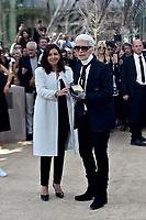 Paris Mayor Anne Hidalgo gives to Karl Lagerfeld the 'Medaille Vermeille de la Ville de Paris' after the Chanel Haute Couture Fall/Winter 2017-2018 show as part of Haute Couture Paris Fashion Week on July 4, 2017 in Paris, France. # LES PEOPLE ARRIVENT AU DEFILE 'CHANEL' A LA FASHION WEEK DE PARIS