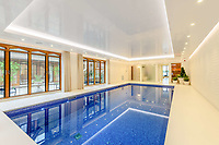 BNPS.co.uk (01202) 558833. <br /> Pic: TailorMade/BNPS<br /> <br /> Pictured: Indoor pool. <br /> <br /> A multi-millionaire is hoping to have a shot at selling his luxury mansion - by throwing a hi-tech golf simulator into the deal.<br />  <br /> Golf-loving Barry Bester put the waterfront property on Sandbanks, Dorset, on the market for £11m last year.<br />  <br /> He is now offering his £40,000 state-of-the-art simulator he has had built on the grounds with the sale.