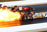 Sep 15, 2013; Charlotte, NC, USA; NHRA top fuel dragster driver Brandon Bernstein has a fire alongside David Grubnic during the Carolina Nationals at zMax Dragway. Mandatory Credit: Mark J. Rebilas-