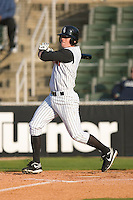 Tyler Kuhn #1 of the Kannapolis Intimidators follows through on his swing versus the Asheville Tourists at Fieldcrest Cannon Stadium April 11, 2009 in Kannapolis, North Carolina. (Photo by Brian Westerholt / Four Seam Images)