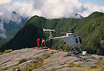 Hughes 500 D Helicopter and deer hunters near Sutherland Sound Fiordland National Park New Zealand