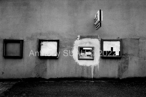 Lom, Czech Republic.July 1997.A town?s first automatic banking machine is installed. Throughout the country cash machines, international phones, nice hotels, good restaurants and modern gas stations can be found..
