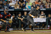 Vanderbilt Commodores outfielder Jeren Kendall (3) follows through on his swing during the NCAA College baseball World Series against the Cal State Fullerton Titans on June 14, 2015 at TD Ameritrade Park in Omaha, Nebraska. The Titans were leading 3-0 in the bottom of the sixth inning when the game was suspended by rain. (Andrew Woolley/Four Seam Images)