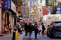 NEW YORK - NEW YORK - MARCH 21: People walk in Chinatown on March 21, 2021 in New York. In the last two months, more than 500 attacks on Asians have been reported in United States. (Photo by John Smith/VIEWpress)