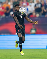 NASHVILLE, TN - SEPTEMBER 5: Alphonso Davies #19 of Canada controls the ball during a game between Canada and USMNT at Nissan Stadium on September 5, 2021 in Nashville, Tennessee.