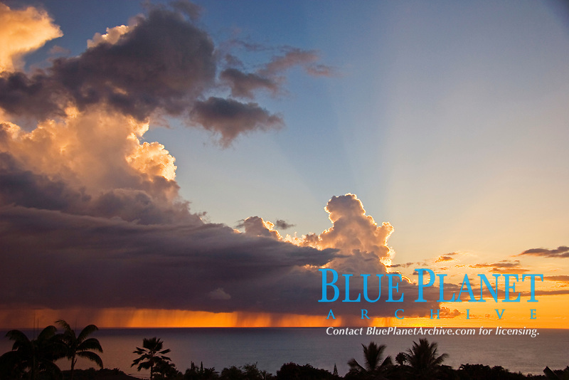 Offshore thunderstorm at sunset with heavy rain pouring from enormous cumulonimbus clouds, Kona Coast, Big Island, Hawaii, Pacific Ocean