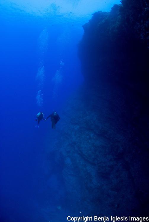Two divers on the back wall Molokini Maui Hawaii