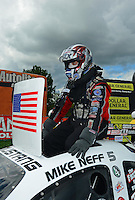 Sept 9, 2012; Clermont, IN, USA: NHRA funny car driver Mike Neff celebrates after winning the US Nationals at Lucas Oil Raceway. Mandatory Credit: Mark J. Rebilas-