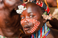 Hamer girl make up  for bull jumping ceremony in Turmi Ethiopia