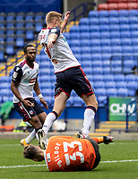 Bolton Wanderers' Eoin Doyle (top) competing with Oldham Athletic's goalkeeper Laurence Bilboe<br /> <br /> Photographer Andrew Kearns/CameraSport<br /> <br /> The EFL Sky Bet League Two - Bolton Wanderers v Oldham Athletic - Saturday 17th October 2020 - University of Bolton Stadium - Bolton<br /> <br /> World Copyright © 2020 CameraSport. All rights reserved. 43 Linden Ave. Countesthorpe. Leicester. England. LE8 5PG - Tel: +44 (0) 116 277 4147 - admin@camerasport.com - www.camerasport.com