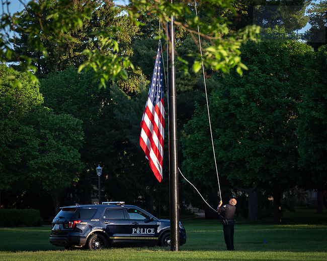 May 26, 2020; Notre Dame Police raise the flag on South Quad. (Photo by Matt Cashore/University of Notre Dame)