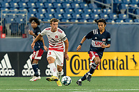 FOXBOROUGH, MA - AUGUST 21: Victor Falck #23 of Richmond Kickers passes the ball as Hikaru Fujiwara #53 of New England Revolution II defends during a game between Richmond Kickers and New England Revolution II at Gillette Stadium on August 21, 2020 in Foxborough, Massachusetts.