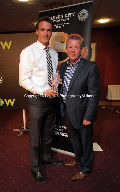 Pictured: Goalkeeper Dorus de Vries (L) being given his award by Martin Morgan. Wednesday 04 May 2011<br /> Re: Swansea City FC supporters Trust annual dinner at the Liberty Stadium, Swansea, south Wales.
