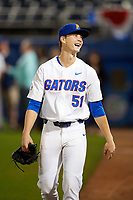 Florida Gators starting pitcher Brady Singer (51) jokes with fans as he walks to the clubhouse after a game against the Siena Saints on February 16, 2018 at Alfred A. McKethan Stadium in Gainesville, Florida.  Florida defeated Siena 7-1.  (Mike Janes/Four Seam Images)