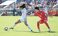 Cary, NC - Sunday October 22, 2017: Christen Press, Kim Hyeyeong during an International friendly match between the Women's National teams of the United States (USA) and South Korea (KOR) at Sahlen's Stadium at WakeMed Soccer Park.