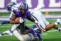 Ryan Maxwell (15) of Fayetteville gets tackled by Josh Thower (12)  and Donnell Packer (47) of North Little Rock at Harmon Field , AR, on Friday,September 10, 2021 / Special to NWADG David Beach