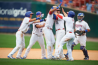 Buffalo Bisons outfielder Dalton Pompey (37) celebrates with Munenori Kawasaki (66), Ryan Schimpf (27), Matt Hague (16), Jonathan Diaz (1) and Sean Ochinko (9) after a game winning hit during a game against the Columbus Clippers on July 19, 2015 at Coca-Cola Field in Buffalo, New York.  Buffalo defeated Columbus 4-3 in twelve innings.  (Mike Janes/Four Seam Images)
