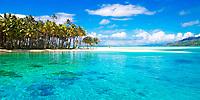 Turquoise Bora Bora lagoon water surrounding a deserted motu island, with beach and palm trees, near Tahiti, French Polynesia, Pacific Ocean